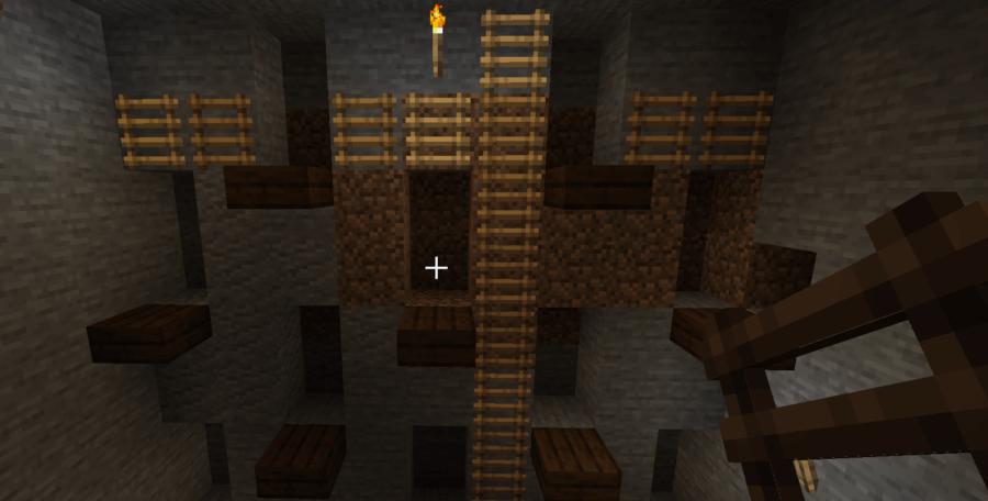 Accès à une mine à ciel ouvert dans Minecraft.