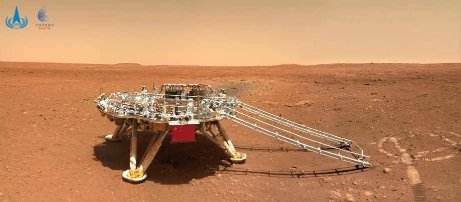 The lander that brought Zhurong to the surface of Mars.  It is possible to see the marks of the rover's wheels in front of the ramp.  Image: CNSA