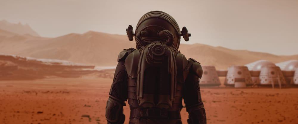 L'image montre des astronautes marchant sur Mars, dans une image qui symbolise la colonisation de la planète rouge